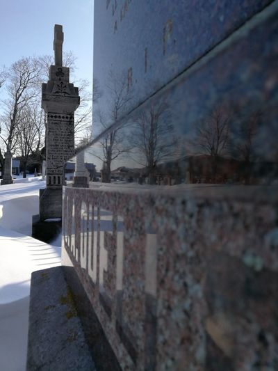 Close-up Reflection Mypointofview Snow Shadows & Lights Peace And Quiet Peaceful Tree Winter Cold Temperature Bare Tree Sky Architecture Built Structure Cemetery Graveyard Mourning Tombstone Gravestone Grave Tomb