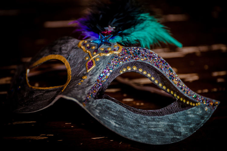 Close-up of venetian mask on table