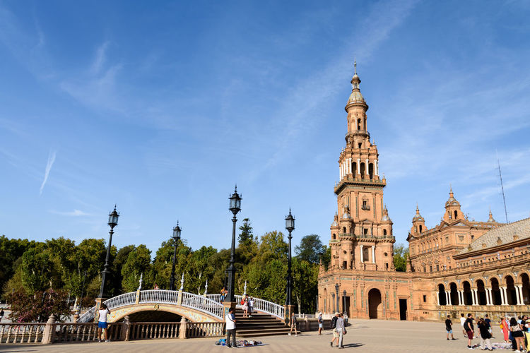 Scenic view of the Plaza de Espana in Sevilla, Spain under a blue sky Architecture SPAIN Sevilla Summertime The Week On EyeEm Travel Travel Photography Traveling Architecture Blue Sky Building Exterior Built Structure City Cloud - Sky Day Fine Art Fineart First Eyeem Photo History Large Group Of People Outdoors People Sky Summer Travel Destinations