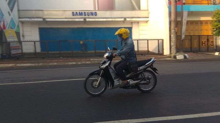Man riding motorcycle on road