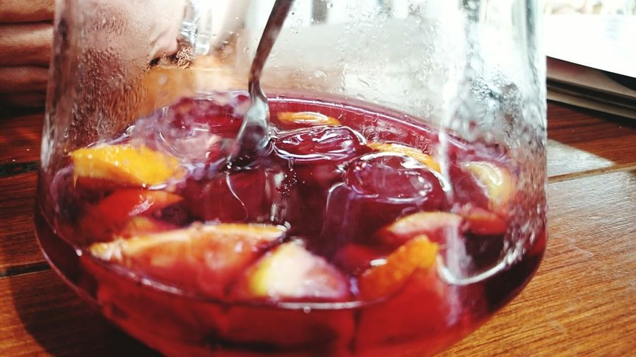 Close-up of fruit slices in drinking glass on table
