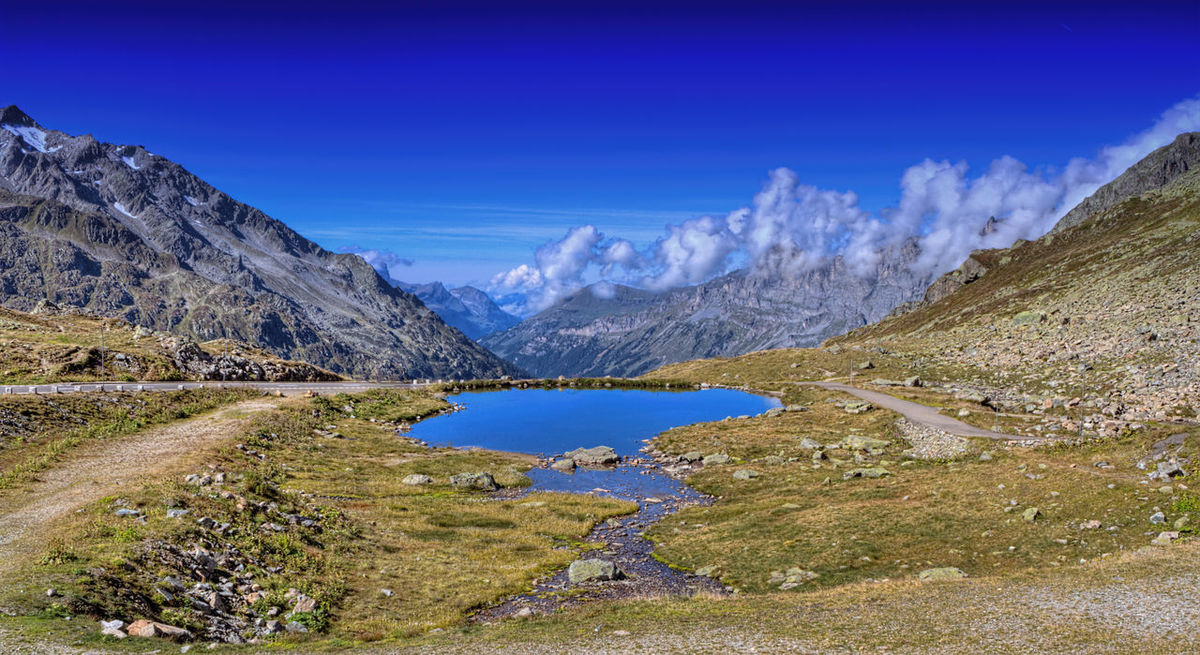 View from Susten Pass Berge Bergpass Luschnat Pass Schweiz Sustenpass Beauty In Nature Bergsee Blue Day Lake Landscape Mountain Mountain Range Nature No People Non-urban Scene Outdoors Physical Geography Scenics Sky Swiss Tranquil Scene Tranquility Water