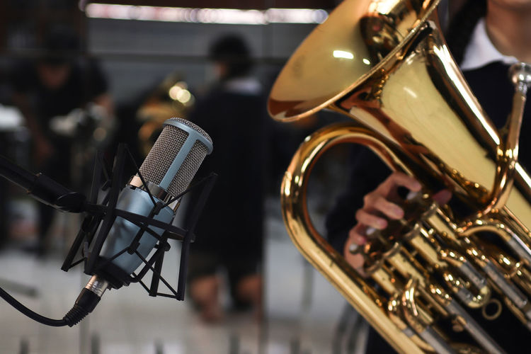 Microphone on Euphonium background Music Musical Instrument Arts Culture And Entertainment Performance Incidental People Brass Instrument  Artist Musical Equipment Focus On Foreground Musician Men Brass Group Of People Playing Metal Close-up Equipment Microphone Holding Input Device Trumpet Orchestra Marching Band