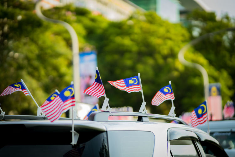 Malaysian flags on cars in city