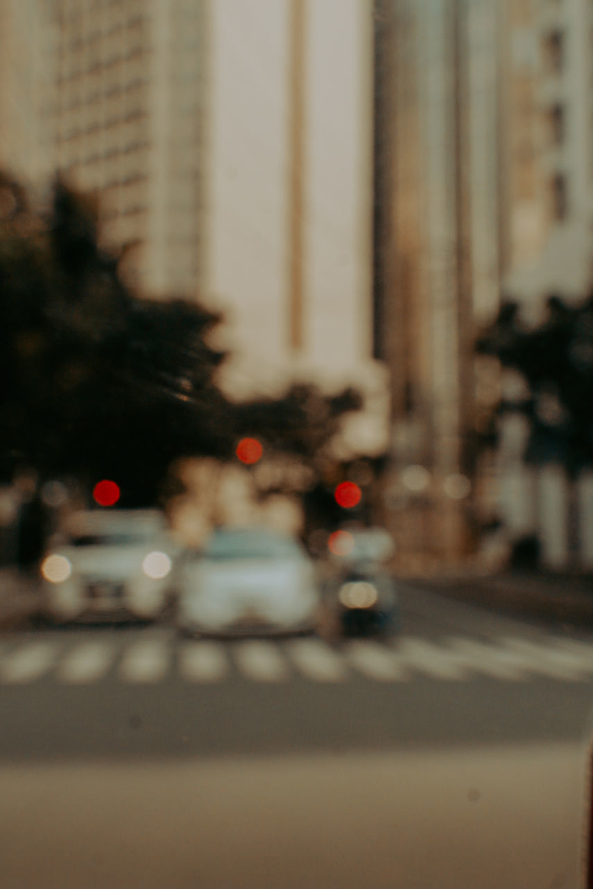 BLURRED MOTION OF TRAFFIC ON ROAD