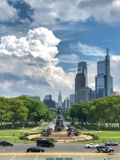 Buildings in city against cloudy sky in philadelphia usa, view from philadelphia museum of art