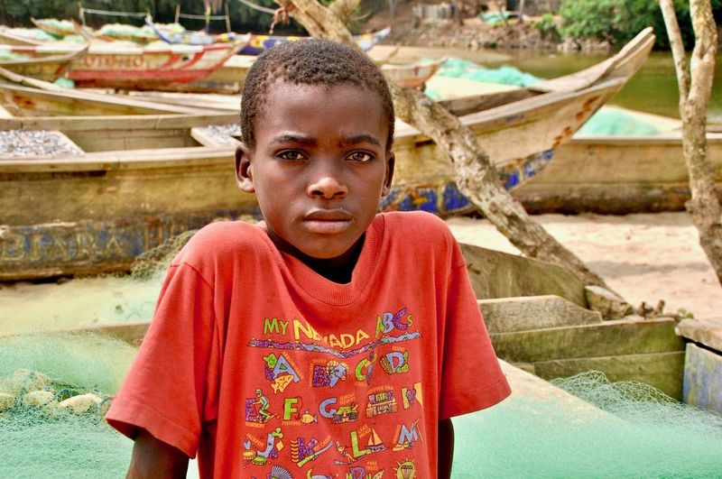 Portrait of boy against boats