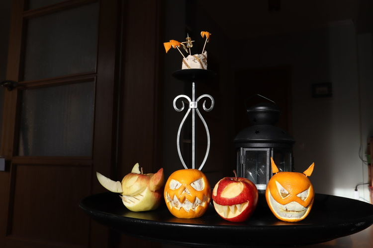 Fruits with anthropomorphic face on table at home
