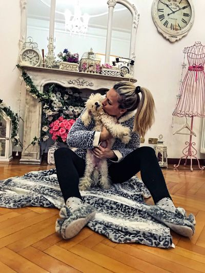 Women Loyalty Hug Love Togetherness Happyness Bonding Poodletoy Poodle Indoors  Pets Dog One Animal Sitting Full Length Home Interior One Person Mammal Animal Themes Blond Hair Hardwood Floor Young Women People Real People