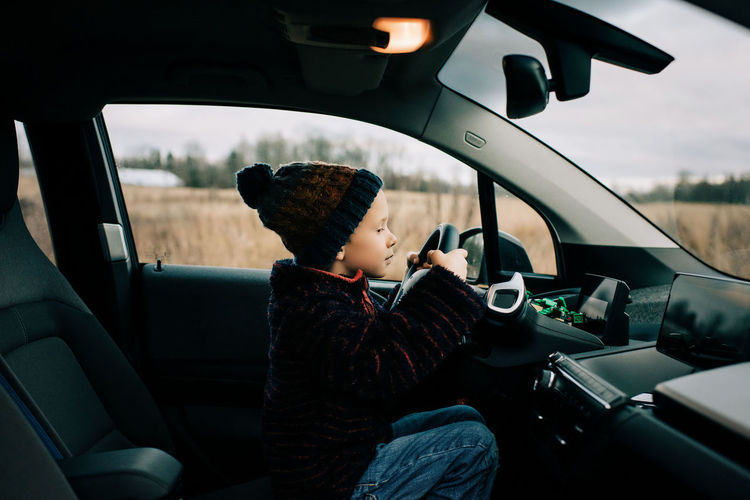 Boy sitting in car