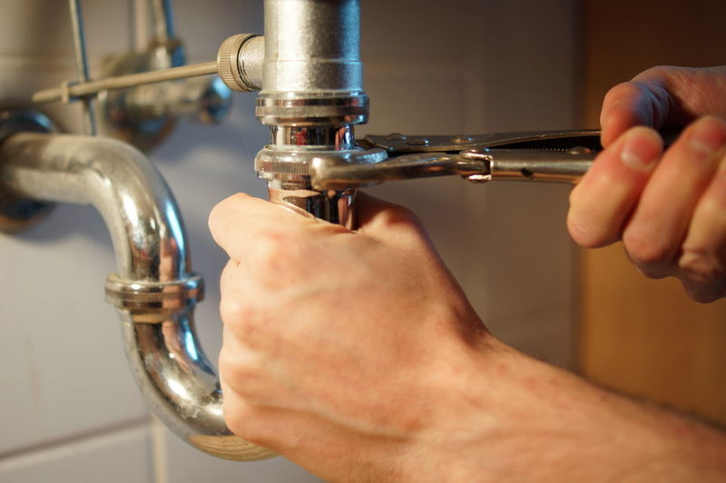 Mechanic Plumbing Work PlumbingSkills Repairing Repairs Service Sink Work Working Working Hard Working Man Contractor Equipment Fixing Hand Holding Human Body Part Human Hand Indoors  One Person Plumber Plumbing Pluming Professional Repair