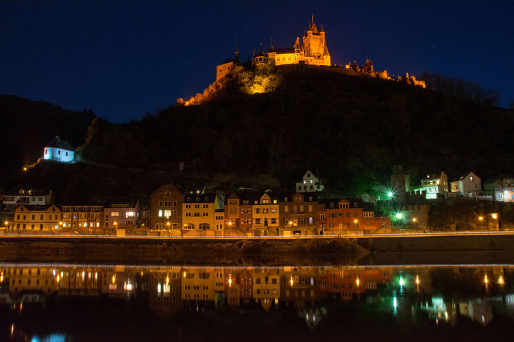 Low angle view of castle on mountain at cochem during night