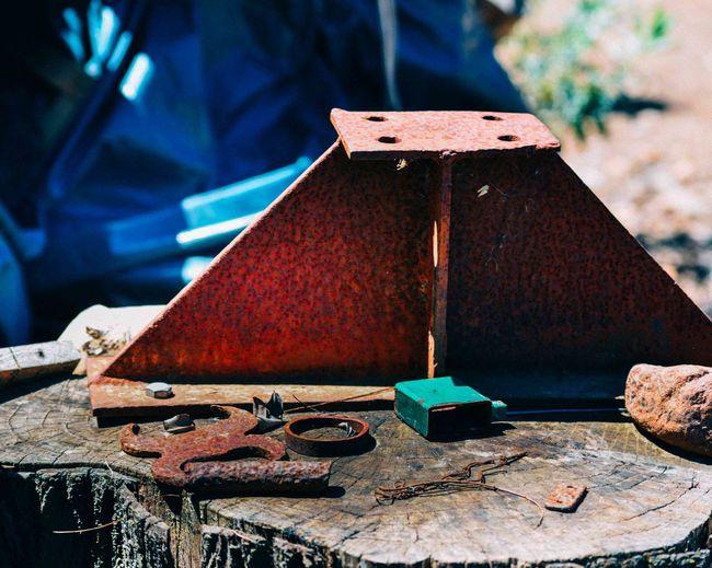 Rusty metal on log