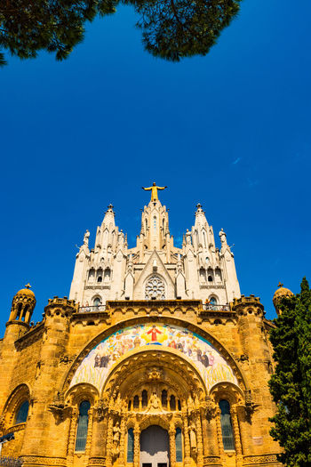 Barcelona Barcelona, Spain Catalonia Catalunya SPAIN Temple Expiatori Del Sagrat Cor Tibidabo Mountain Tibidabo's Church Architecture Blue Building Exterior Built Structure Clear Sky Day Façade Go-west-photography.com History Low Angle View No People Outdoors Place Of Worship Religion Sky Spirituality Tibidabo Tibidabo Cathedral Del Sagrat Cor Travel Destinations Tree