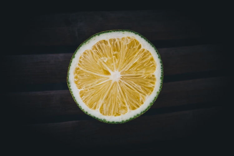 citrus on dark wooden background Food And Drink Food Fruit Healthy Eating SLICE Freshness Cross Section Still Life Citrus Fruit Close-up Studio Shot No People Halved Black Background Circle Shape Single Object Table Antioxidant Vitamin C Round Backgrounds Copy Space Lemon Lime My Best Photo