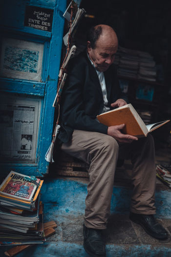 Man sitting on book