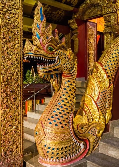 Railing Religion Architectural Column Architecture Art And Craft Buddhist Built Structure Chinese Dragon Day Dragon Gold Colored Indoors  Multi Colored Naga No People Place Of Worship Religion Sculpture Serpent Head Spirituality Statue Temple