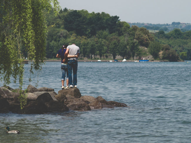 Love at the lake Adventure Beauty In Nature Casual Clothing Day Enjoyment Full Length Idyllic Leisure Activity Lifestyles Love Nature Outdoors People Rippled Scenics Tourist Tranquil Scene Tranquility Tree Vacations Water