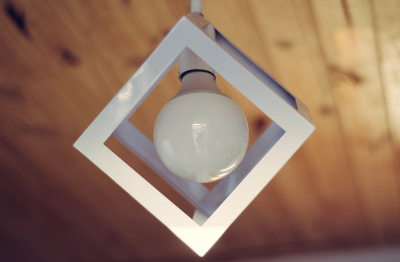 Low angle view of illuminated pendant light on ceiling