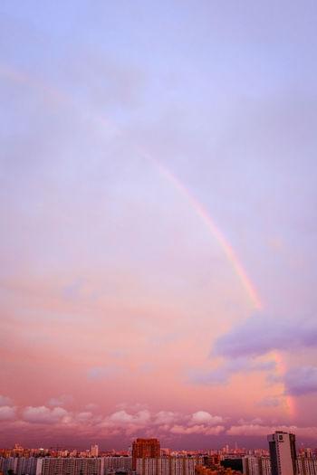 Light line --- Half a rainbow against a pink sunset above the city Evening Evening Sky Light Light Lines Clouds Landscape Nature Pink Color Salmon Colored Blue City Cityscape Urban Skyline Multi Colored Sunset Rainbow Sky Cloud - Sky Building Exterior Romantic Sky Dramatic Sky Moody Sky