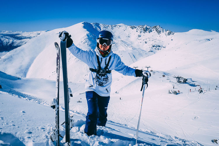Man skiing on snowcapped mountain during winter