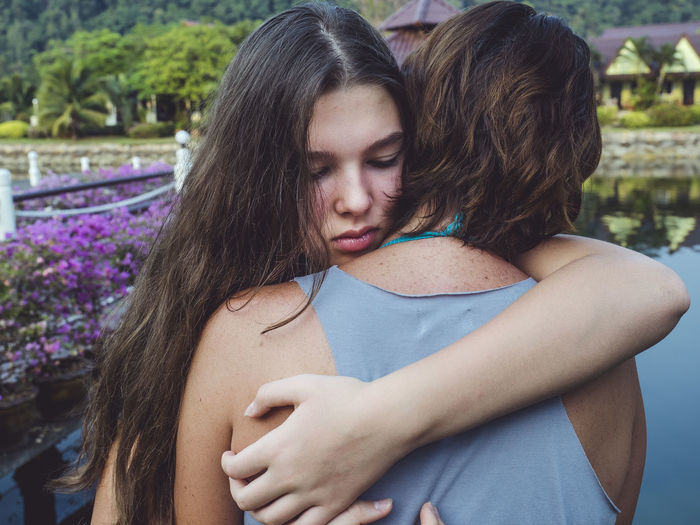 Two People Women Couple - Relationship Togetherness Real People Young Adult Love Young Women Leisure Activity Embracing Lifestyles Long Hair Bonding Positive Emotion Adult Emotion Heterosexual Couple Headshot Hairstyle Hair