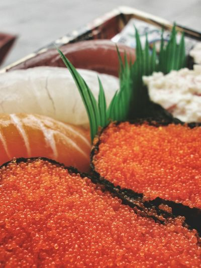 Close-up of red caviar sushi