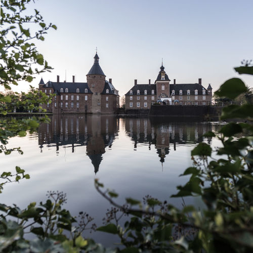 The water castle of Anholt at 5am with a perfect mirror... Anholt Architecture Building Exterior Built Structure Castle Castle Clear Sky Day Deutschland Germany Mirror Morning Nature No People Outdoors Reflection Reflection Schloss Sky Sunrise Travel Destinations Tree Water