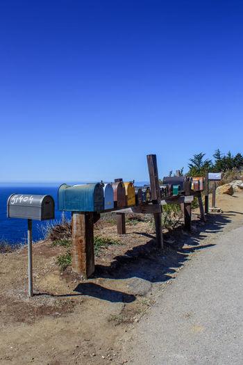 Blue Chaos Clear Sky Coastal Life Day Landscape Mailbox No People Outdoors Random Sky Sunny