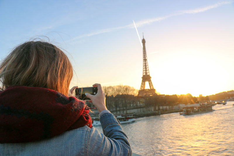 The mobile photographer. Built Structure Capital Cities  Casual Clothing City Day Eiffel Tower Famous Place Girl International Landmark Leisure Activity Lifestyles Mobile Photography Outdoors Sky Sunset Tall - High Tourism Tourist Travel Destinations Up Close Street Photography Mobile Conversations