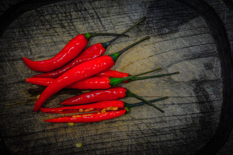 Chilli is a friend of your weight Close-up Day Food Food And Drink Freshness Healthy Eating High Angle View Indoors  Ingredient No People Red Red Chili Pepper Spice Still Life Wood - Material พริก พริกขี้หนู