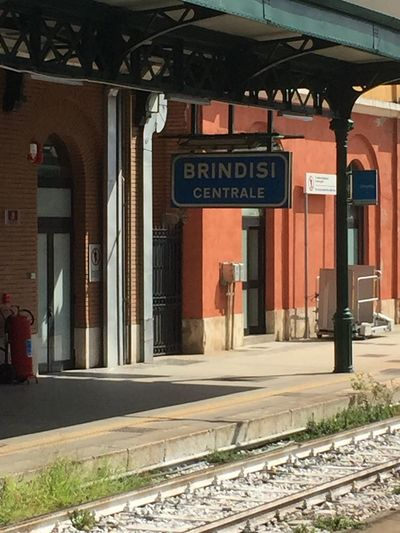 Brindisi centrale Text Communication Architecture Western Script Sign Built Structure Building Exterior