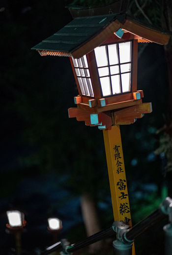 Focus On Foreground Lighting Equipment Text Communication No People Script Lantern Night Non-western Script Belief Outdoors Spirituality Place Of Worship Hanging Architecture Religion Built Structure Shrine Electric Lamp