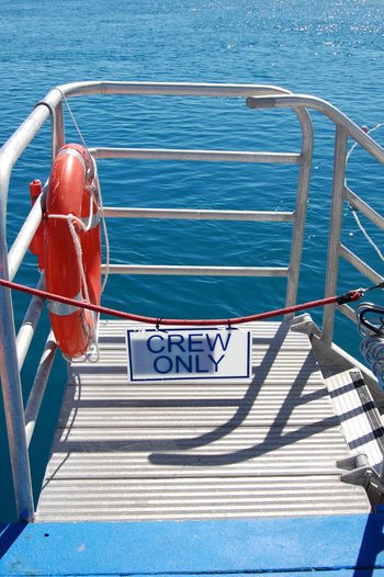 Boat on the Great Barrier Reef Queensland Australia Water Safety Railing Security Protection Sea Nautical Vessel Life Belt Day High Angle View No People Sunlight Nature Blue Transportation Mode Of Transportation Text Communication Outdoors Crew Only Sign Great Barrier Reef Australia Life Ring