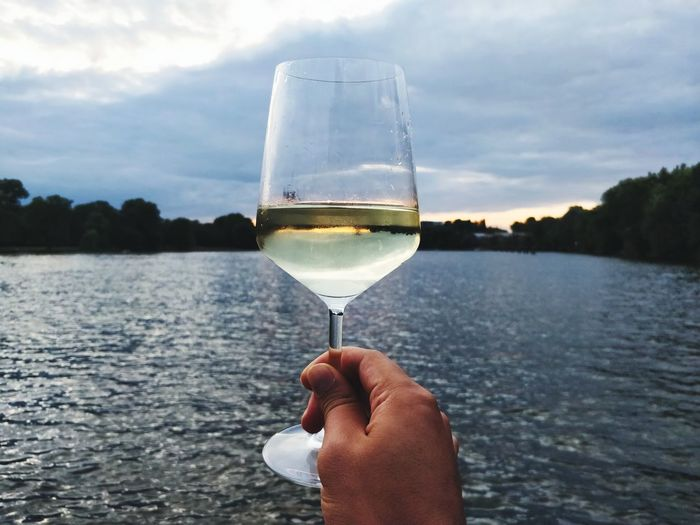 EyeEmOnABoat ABoatTime Human Hand Water Wineglass Alcohol Drink Wine Lake Holding Drinking Glass Personal Perspective Champagne Flute Alcoholic Drink Glass White Wine Beverage