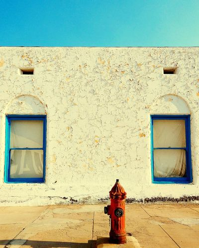 Old building against blue wall