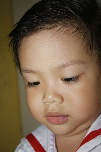 Close-up of cute baby boy at school