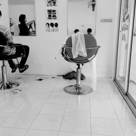 Its time to cut a hair. Lifestyles Real People Men Day Indoors  Barber Hairstyle Haircut Cut