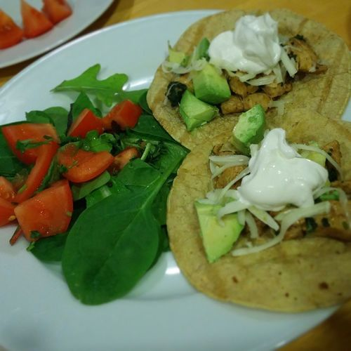 Light and delicious dinner at Gina's diner...Lemon cilantro chicken tacos, topped with avocado, pepper jack cheese, sour cream and served with greens, with tomatoes and salsa ranch yogurt dressing. Tacos Recipes Ginasdiner