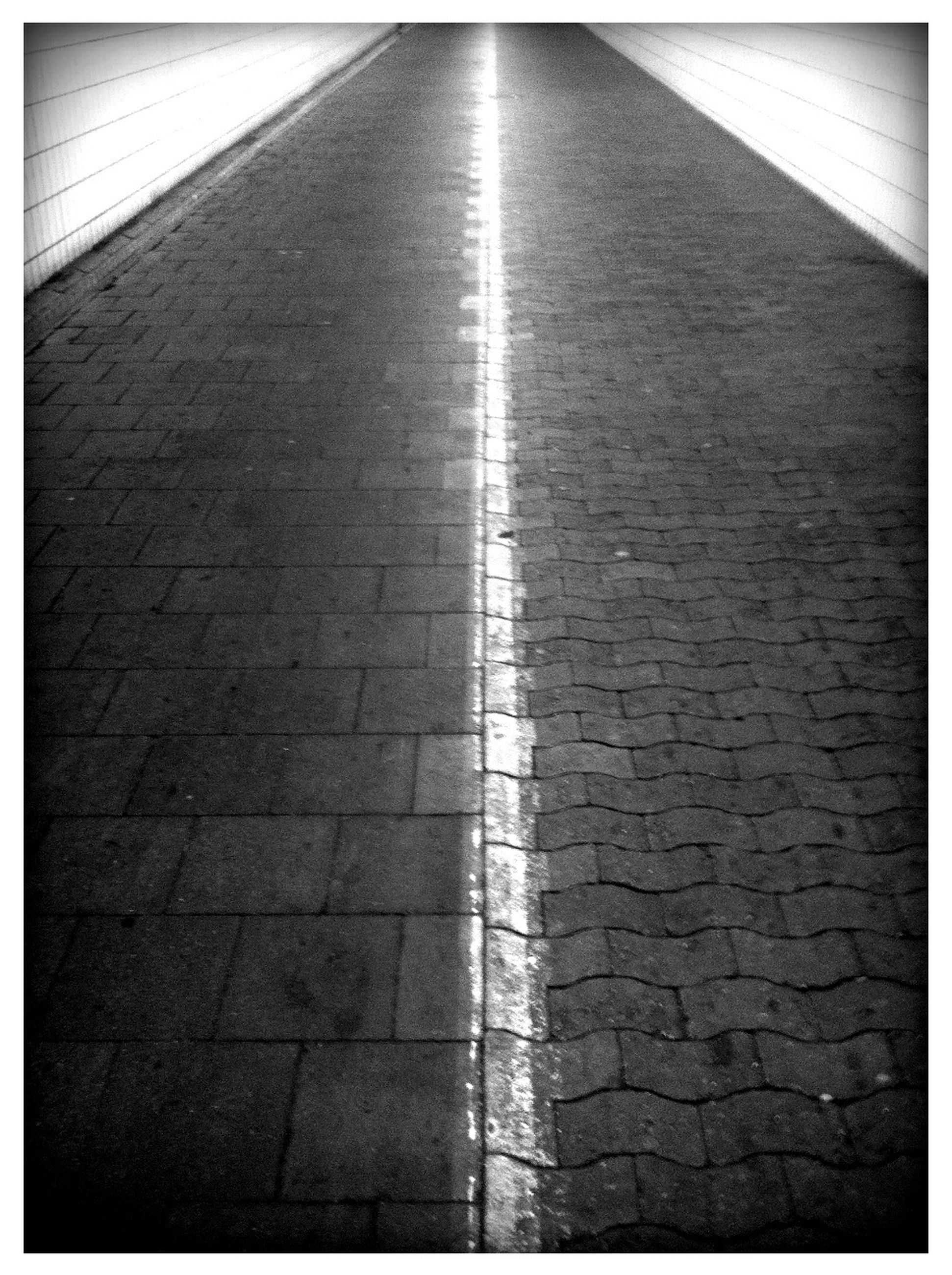 transfer print, auto post production filter, tiled floor, paving stone, cobblestone, the way forward, pattern, flooring, sunlight, shadow, indoors, diminishing perspective, tile, wall - building feature, walkway, textured, built structure, empty, footpath, architecture