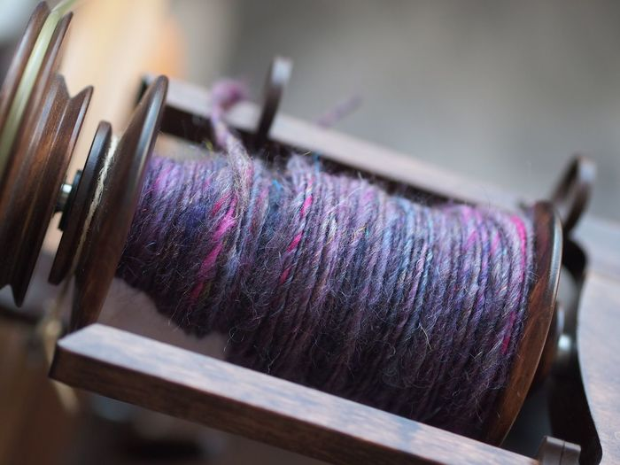 Spinning Spinning Wheel Handmade Yarn Handspunyarn Handspun Handspun Yarn EyeEm Selects Indoors  Art And Craft No People Close-up Thread Focus On Foreground Still Life Textile Selective Focus Wool Craft Creativity Purple Equipment Man Made Object