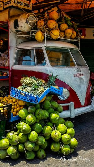 Costa Rican Volkswagen Front Fruit STAND in Sanjosé Costa Rica Filled with Pineapple Coconut Streetphotography Travel Photography Travel Urbanphotography City Life Photo Of The Day Ronlouisphotos