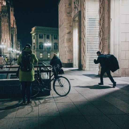 Woman walking in city at night