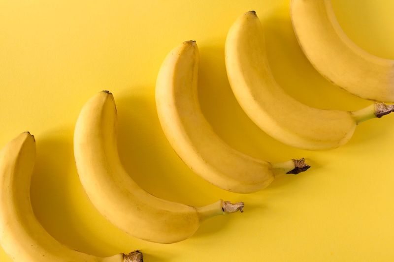 Bananas in a row on yellow background Individuality Symmetrical Simple Summertime Monocrome Monochromatic One Color Minimalism Design Sweet Food Tropical Raw Food Creativity Vegan Food Vitamin Organic Dieting Vegetarian Yellow Banana Fruit Healthy Eating Yellow Background Freshness Wellbeing Close-up Healthy Lifestyle Studio Shot