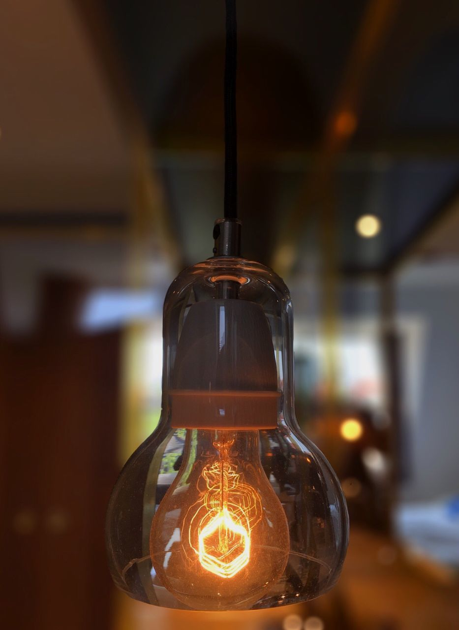 focus on foreground, close-up, indoors, illuminated, no people, light bulb, electricity, filament, day