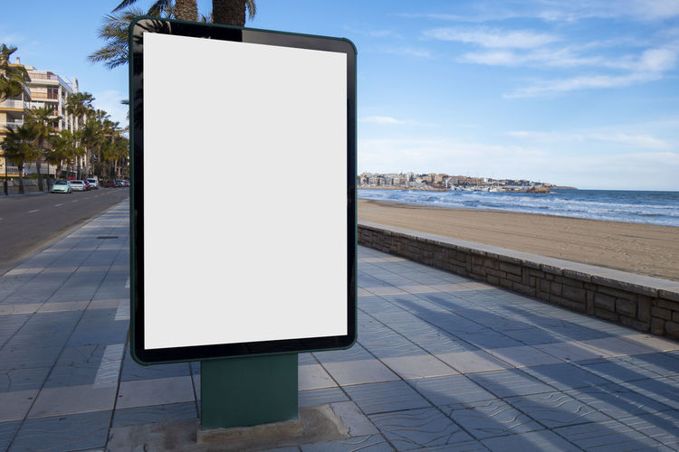Blank billobard mock up Sky Communication Blank City Copy Space Sea Nature Water Footpath Architecture No People Road Street Outdoors Sign Day Empty Advertisement Placard Building Exterior Modern Marketing Blank Billboard Billboard Mock Up