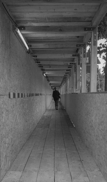 Keep on Walking Architecture Built Structure The Way Forward Rear View Real People Full Length Walking Leisure Activity Tunnel Lifestyles Day One Person Women People Wooden Straight Forward Black And White Black & White IPhoneography