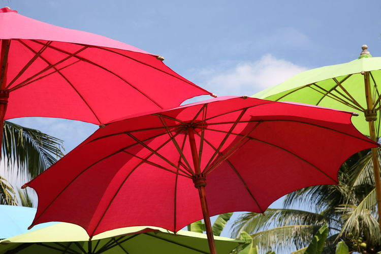 Low angle view of red umbrella against sky