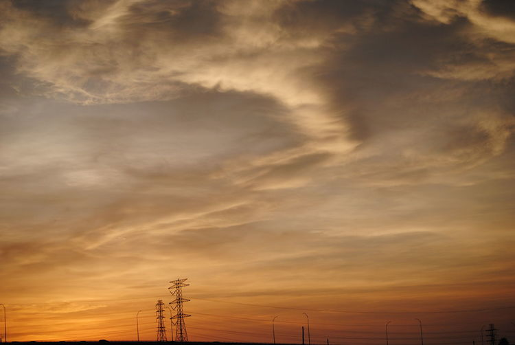 Beauty In Nature Cable Cloud - Sky Cloudy Dramatic Sky Idyllic Landscape Low Angle View Majestic Nature Non-urban Scene Orange Color Outdoors Overcast Power Line  Power Supply Scenics Silhouette Sky Sunset Tranquil Scene Tranquility Weather Showcase July 43 Golden Moments