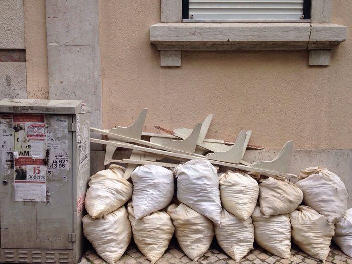 Stack of sacks outside building
